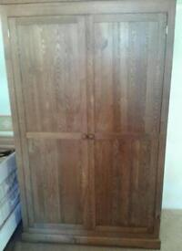 Light solid oak double wardrobe as new condition