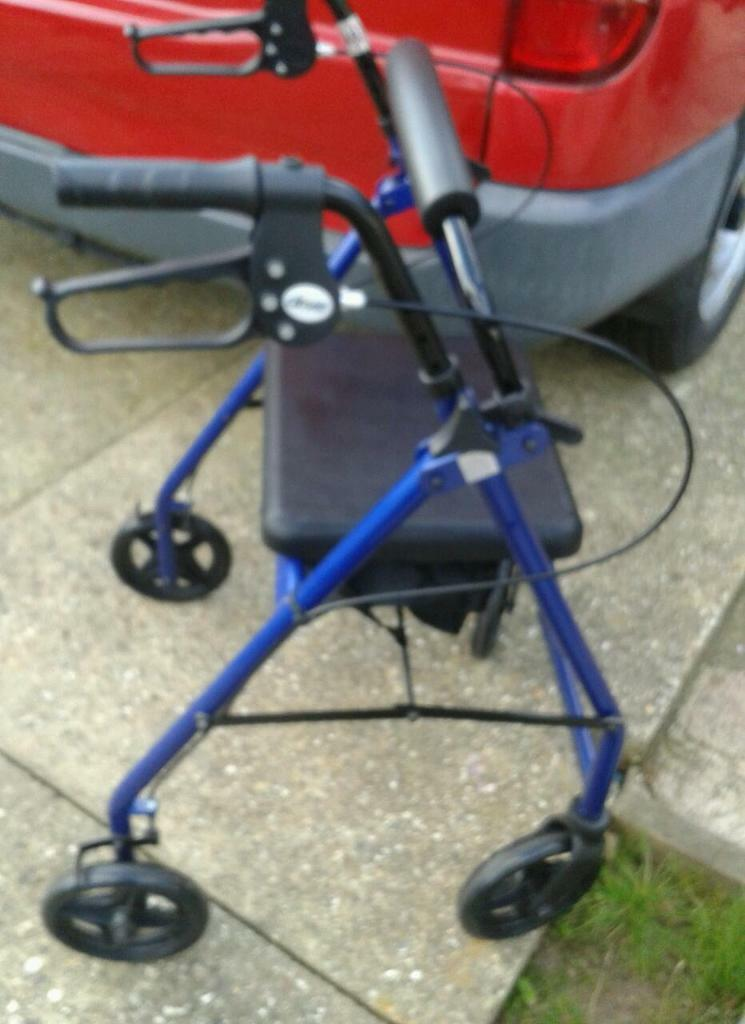 DISABLED FOUR WHEELER MOBILITY WALKER WITH BRAKES AND SEAT AS NEW CONDITION