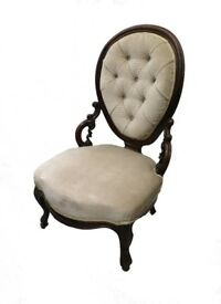 A Victorian rosewood frame scroll carved nursing chair