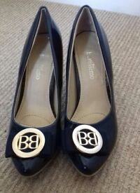 Ladies size 4 Bellissimo navy blue heels with Gold BB design