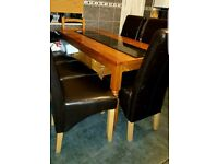 Pine dining table and four highback chairs