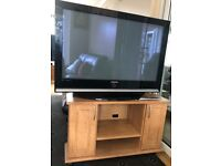 Samsung 42 inch TV with remote, comes with a solid oak tv stand. Good condition, hardly been used.