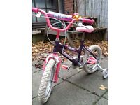 Magna Wild pink and purple kids girls bicycle with stabilisers