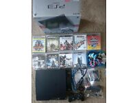 BoxedPlaystation 3 (PS3) slim 250gb with accessories and games, inc Skylanders Superchargers