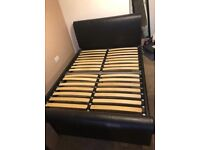Brown leather sleigh bed
