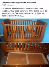 Toys r us Sleigh cotbed in teak with underbed storage drawer.