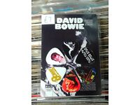 Brand new pack of 6 David Bowie themed guitar picks.