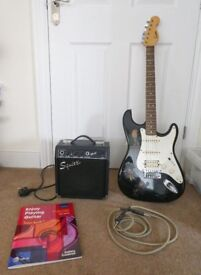 Electric Guitar with Amp, lead, plectrum and music book