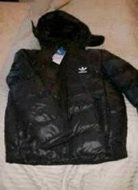 Adidas originals padded black puffa jacket. Funnel neck with removeable hood. Medium. Brand new