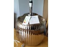 table lamp base, polished chrome. quite large. brand new never used. from Oak Furniture Land