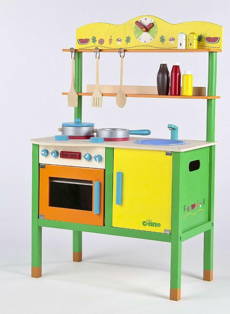 John crane petite cuisine childrens kitchenin Nottingham, NottinghamshireGumtree - Colourful Wooden childrens play kitchen with utensils and pansBrand new boxed so perfect condition To be collected