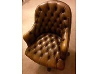 Brown leather button chair