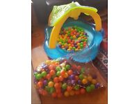 Inflatable kids ball pool with full bag of plastic balls. Great for indoor play