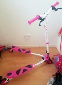 Selling a pink and white v-rider scooter