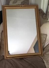 Mirror in a gold coloured frame.