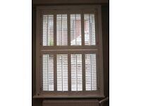 Two White Wooden Window Shutters