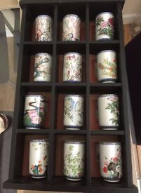 Set of 12 Collectible Cups in Display Case