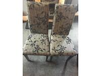 2 black and grey dining chairs
