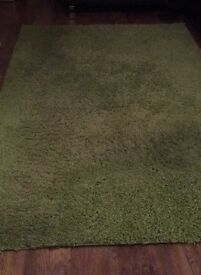 Very large green shaggy rug 5ft by 7ft 8