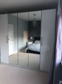 IKEA PAX tall high gloss white and mirror 5 door wardrobe. Immaculate condition.