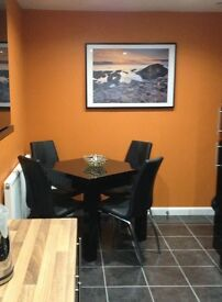 Next Gloss Black Square to Rectangle Table and Chairs - Square to Rectangle