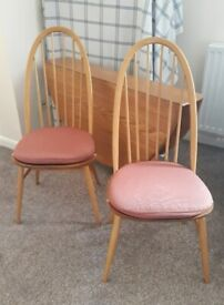 Two Ercol Windsor dining chairs with seat cushions (Delivery available)