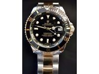 Automatic Black and gold Rolex Submariner