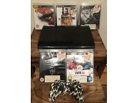 Sony Playstation 3 Super Slim Console with 1 Controller & 5 Games