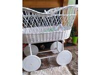 Large wheeled wicker crib