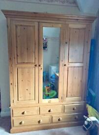 Solid Pine Triple Wardrobe. Central mirror and 5 draws