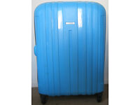 Large Tripp Suitcase with 4 wheels. and combination lock.