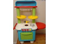 Children's play kitchen with pots and pans, fruit and veg (great for Grandma's house)