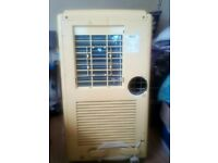 Air Conditioning Unit. had rare use. 2 top slats and air intake filter missing. functions perfectly