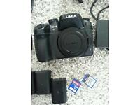 Gh4 with 3 batteries, 2 chargers, lumix lens 14-45, 128 gb sd card