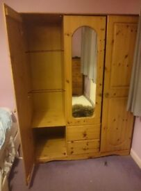 3 door, 2 drawer Pine Wardrobe. Dismantled, with centre mirror door, two drawers and shelves