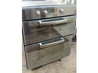 HOTPOINT,BUILT UNDER ELECTRIC DOUBLE OVEN.GREY/SILVER GLASS FRONTED. IMMACULATE