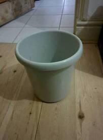 Grey waste paper bin