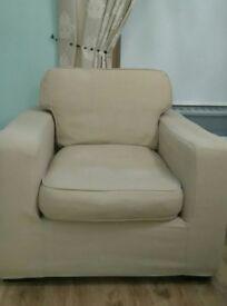 Cream/caramel coloured armchair for sale.