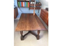Vintage oak farmhouse refectory dining table with cross stretcher and barrel legs