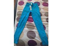 Turquoise leggings ( size 8 )