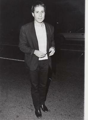 Paul Simon out shopping In Beverly Hills Dated: 8/25/83 & captioned back 7x9