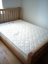 Solid oak double bed with mattress in perfect conditions, barely used!!