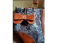 A stylish new medium sized animal print shoulder bag. No tags.