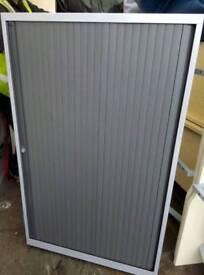 Mid height tambour door unit