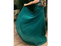 Prom Dress , worn once in good contidion , teal colour , mesh material at the back, size 16-18