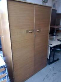 His and her teak wardrobes