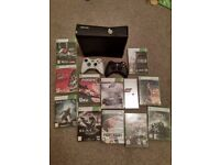 Xbox 360 slim 4gb, 11 games, two controllers and media remote.