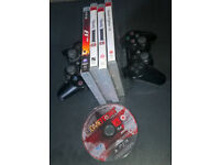 2 x wireless playstation controllers + 4 games