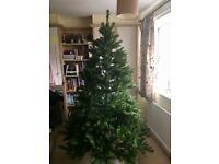 Artificial Christmas tree nearest likeness to real tree
