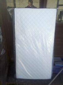 Brand new cot mattress still wrapped size is 1310x680x100